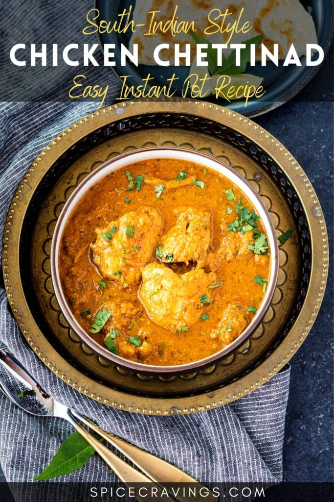 Chicken curry in bowl over brass decorative plate