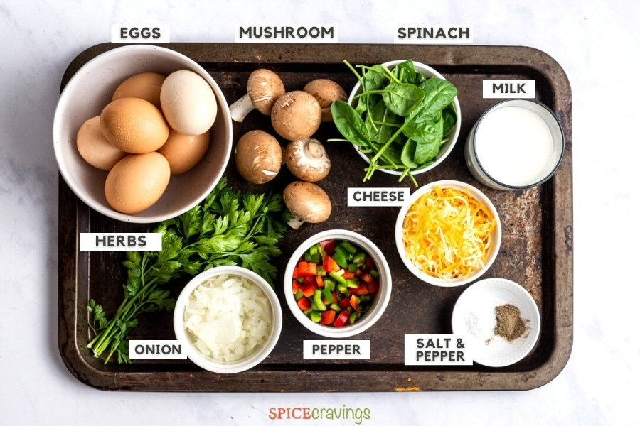 frittata ingredients on a metal rustic tray