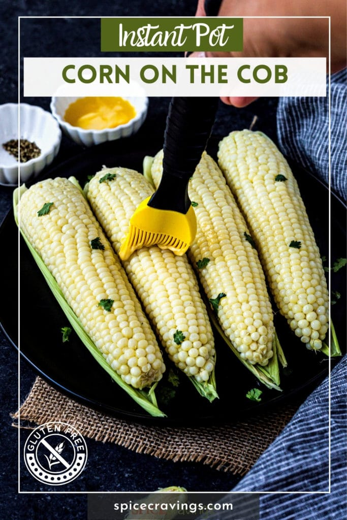 """corn being brushed with butter titled """"Instant Pot Corn on the Cob"""""""